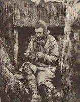 Not exactly all the comforts of home..A Tommy enjoys a bit of bully in a cold, wet and poorly made trench