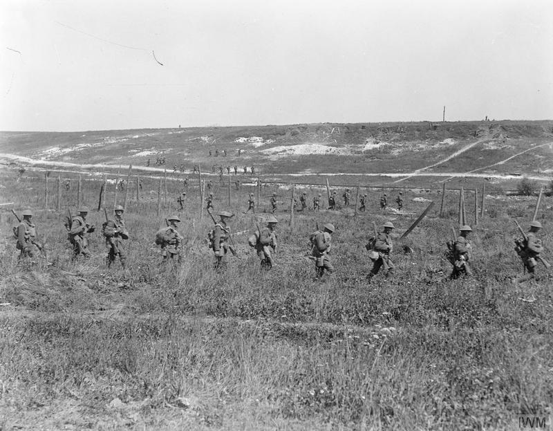 Troops of the 12th Battalion, Gloucestershire Regiment (5th Division) advancing in artillery formation parallel to the Bucquoy - Achiet-le-Petit road to capture Achiet, Battle of Albert, 21 August 1918. Imperial War Museum image Q11504