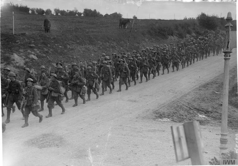 Troops of the 7th Battalion, King's Shropshire Light Infantry Regiment, returning from the trenches; near Toutencourt, 18th May 1917. Imperial War Museum image Q2160