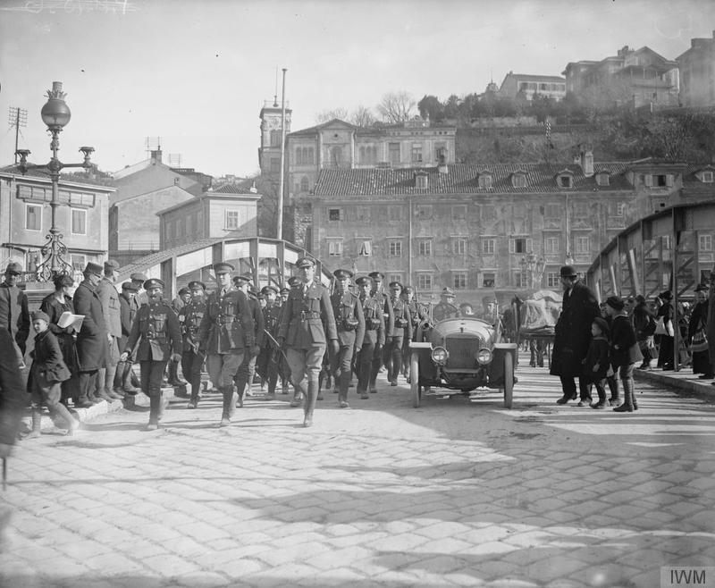 Troops of the 8th (Service) Battalion, York and Lancaster Regiment marching across bridge dividing Fiume (Rijeka) and Susak. Imperial War Museum image Q26407