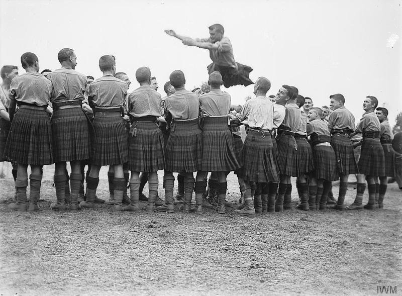 A physical training game of the troops of the 9th Battalion, Highland Light Infantry (Glasgow Highlanders), 100th Brigade, 33rd Division, at Ghyvelde, 6th August 1917. Imperial War Museum image Q2686