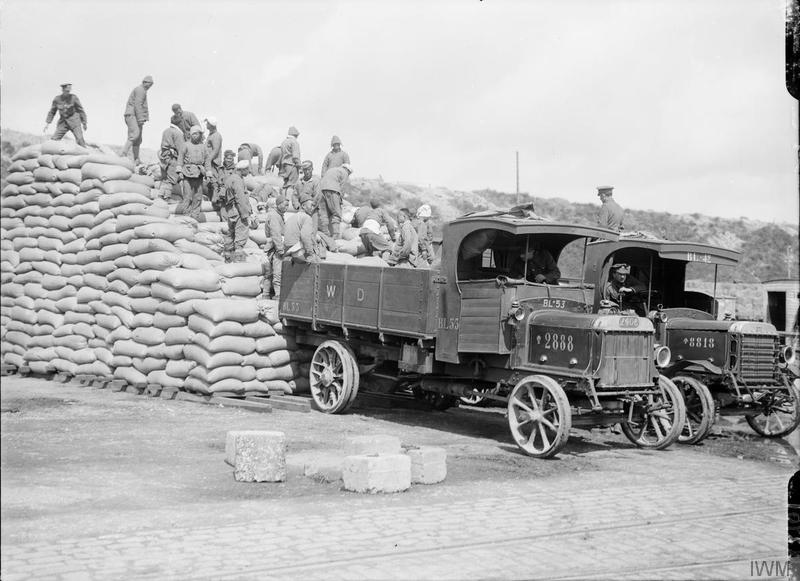 Men of the Chinese Labour Corps stacking sacks of corn at Boulogne, 12 August 1917. Imperial war Museum image Q2701