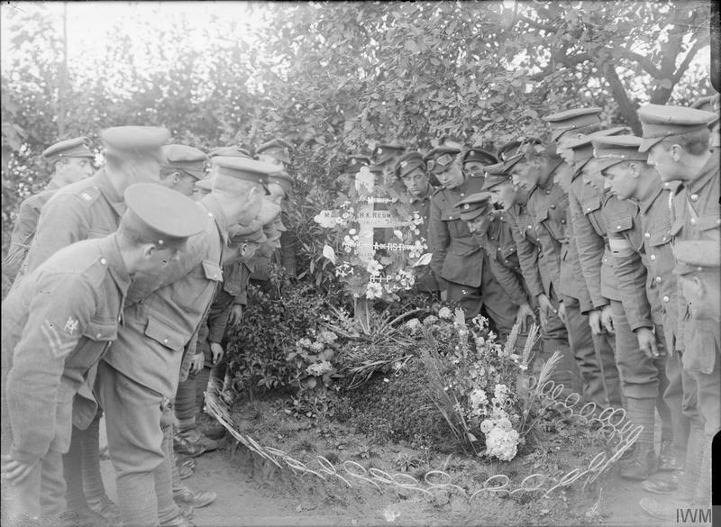 Visit of a deputation from Ireland to the grave of Major William Redford, 6th Battalion, Royal Irish Regiment, at Locre (Loker), 21st September 1917. Northern and Southern Irish troops were present. Imperial War Museum image Q3043