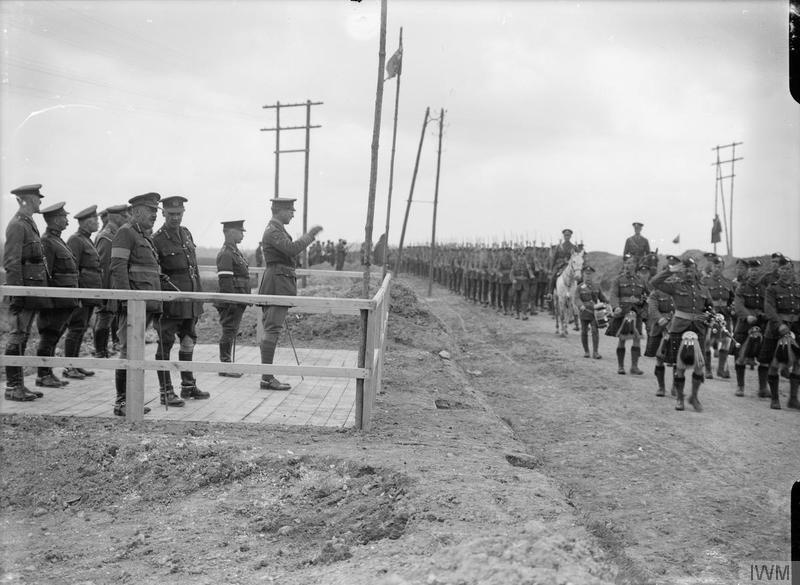 Albert I, King of Belgium, taking the salute at the review of the 2nd Guards Brigade at Curlu, 15th May 1917. Shows Field Marshal Frederick Rudolph Lambart, 10th Earl of Cavan; General Henry Seymour Rawlinson, 1st Baron Rawlinson; and others. Imperial War Museum image Q3135