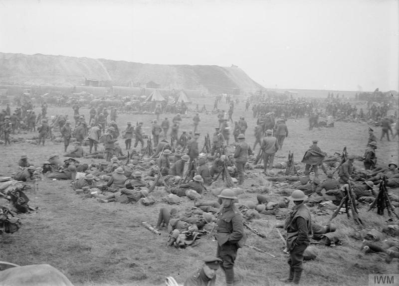 Men of the Royal Irish Regiment near Bertincourt awaiting orders to advance. Battle of Cambrai, 20 November 1917. Imperial War Museum image Q3199