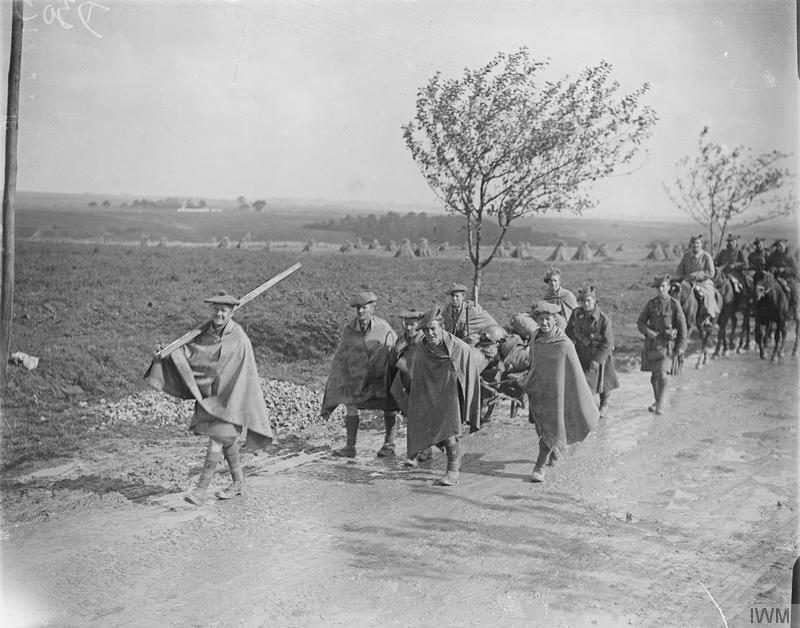 Troops of the 1/9th (Highlanders) Battalion, Royal Scots marching in wet weather. Amiens-Albert road, Somme, September 1916. Imperial War Museum image Q4263