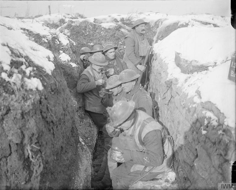 Troops of the 6th (Service) Battalion, Queen's (Royal West Surrey Regiment) eating dinner in the trenches. Arras, March 1917. Imperial War Museum image Q4844
