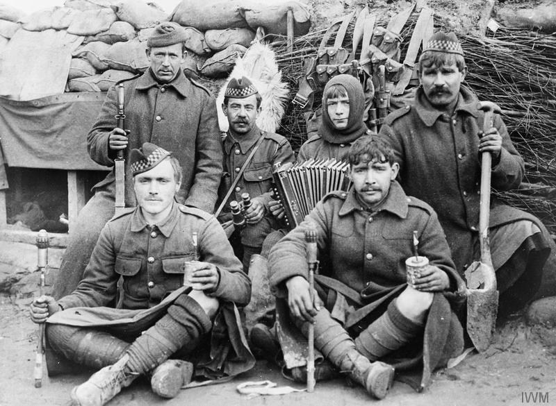 2nd Battalion Argyll and Sutherland Highlanders. A group of men in the trenches of the Bois-Grenier sector. Note the jam-tin bomb and rifle grenade, brushwood revetting and dug-out in parapet. One man has an accordion. Imperial War Museum image Q48958.