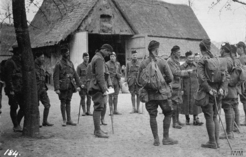 Colonel C. B. Vandeleur is introduced to his officers; 2nd Battalion Cameronians (Scottish Rifles), 27 April 1915. Imperial War Museum image Q51608