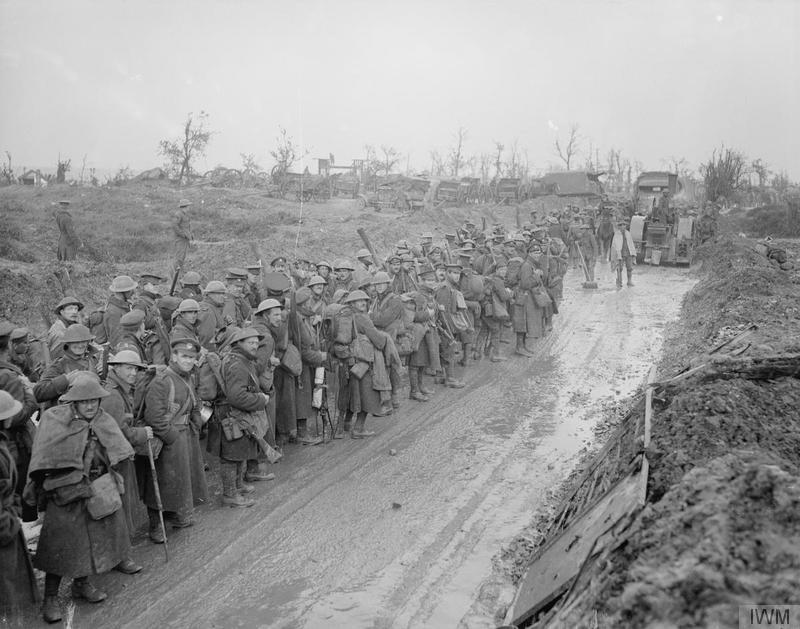 Troops of the 2nd Battalion, South Wales Borderers, on the road to the trenches in the rain at Montauban, October 1916. Imperial War Museum image Q5320