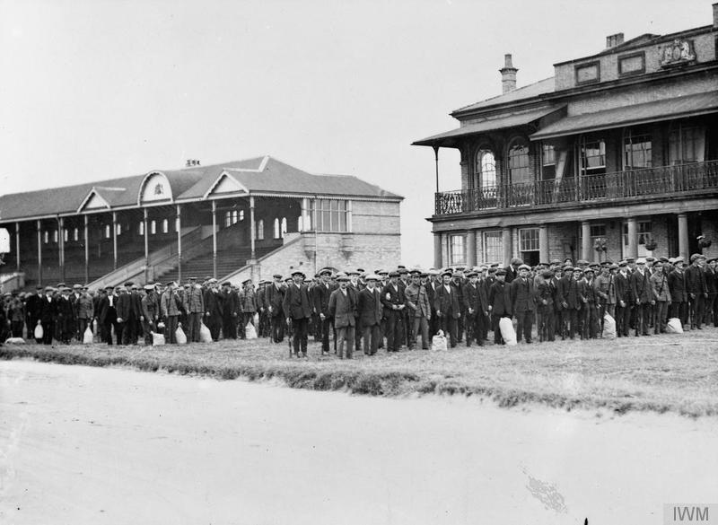 New recruits to the Lincolnshire Regiment parade on a racecourse prior to leaving for Grantham, September 1914. Imperial War Museum image Q5325