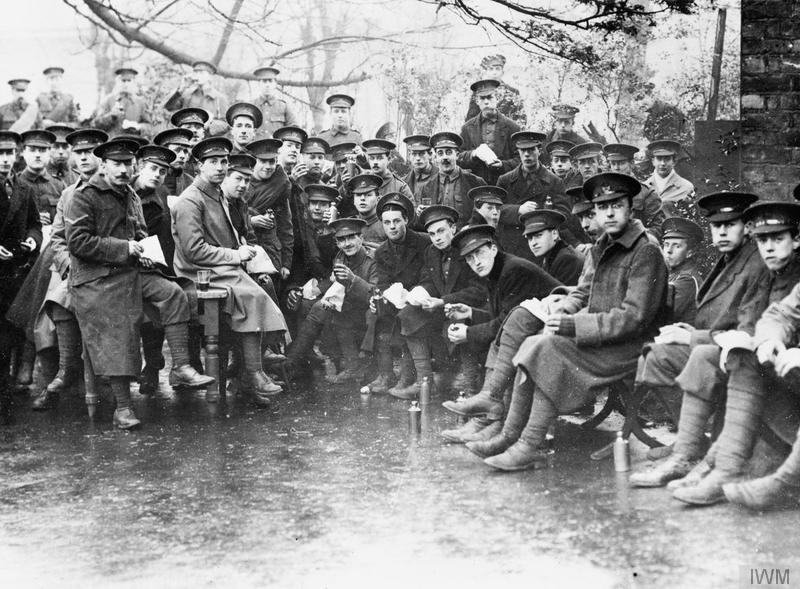 Men of the 9th London Regiment (Queen Victoria's Rifles) during a break in training on Hampstead Heath in December 1914. Imperial War Museum image Q53457.
