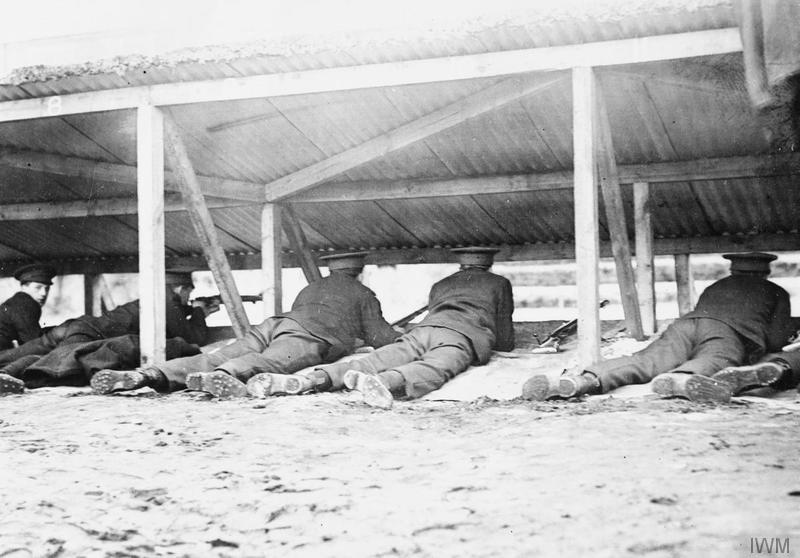 Soldiers of the 8th (Service) Battalion, Welsh Regiment firing on a rifle range in Winton, 17 January 1915. Imperial War Museum image Q53544