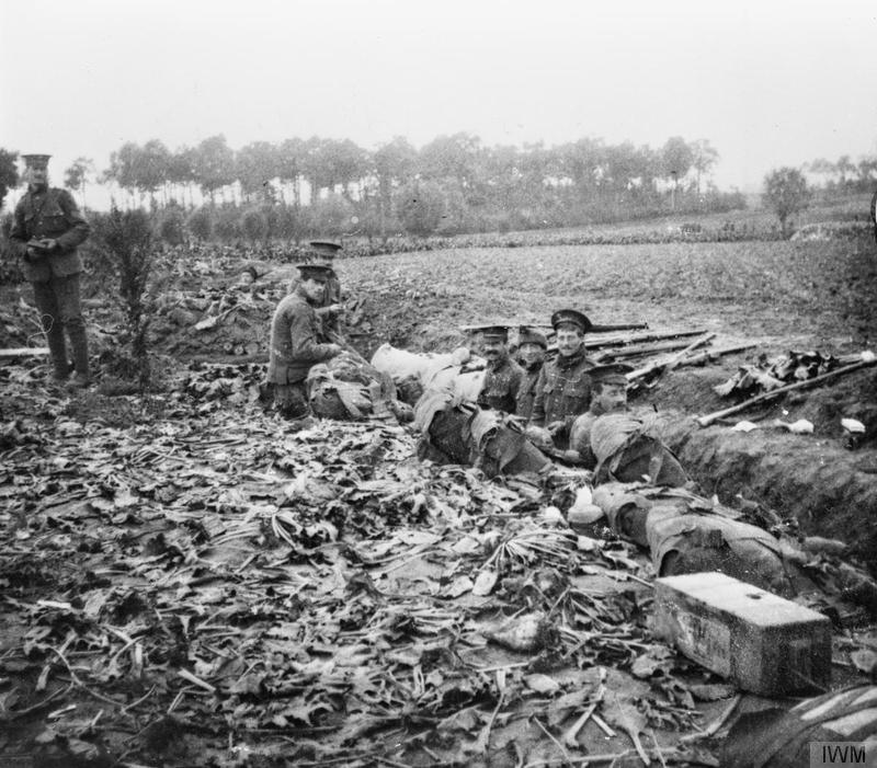 Soldiers of the 2nd Battalion, Scots Guards in the hastilly constructed trenches near Zandvoorde, October 1914. Imperial war Museum Q57228