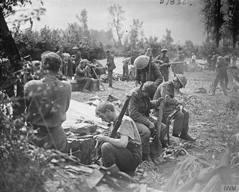 Men of the Yorkshire Regiment (Green Howards) cleaning their rifles after coming out of the line, 3 August 1917. Imperial War Museum image Q5771