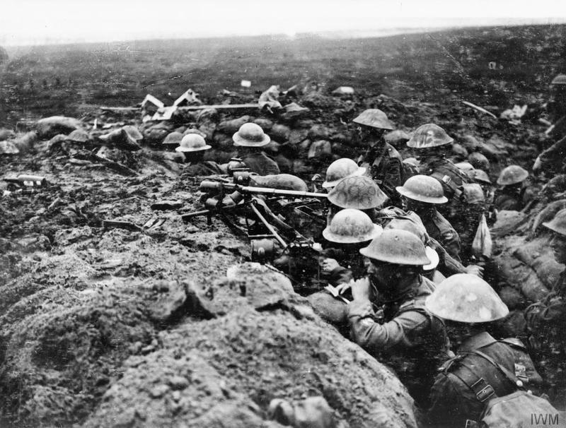 A signals section of the 13th (Service) Battalion, Durham Light Infantry, equipped with telescopes, field telephone and signalling lamps, watch the battalion's advance on Veldhoek on 20 September 1917. Battle of the Menin Road. Imperial War Museum image Q5971