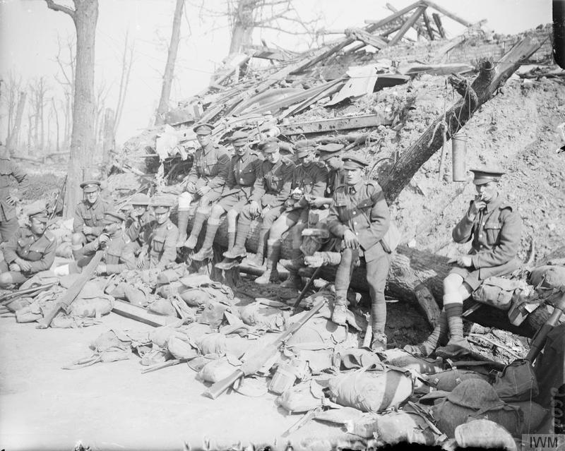 Men of the King's Own Yorkshire Light Infantry resting on the way down from the trenches, near Wieltje, Ypres, 1 October 1917. Imperial War Museum image Q6026