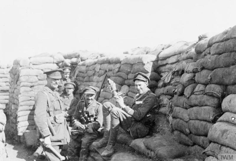 Officers of 'B' Company, 1/6th Battalion, South Staffordshire Regiment in No.38 Trench, Hill 60, three miles south-east of Ypres during March 1915. Left to right: Lieutenant Walter Nelson, Major Edwin Lewis, Lieutenant Gerald Howard Smith. Imperial War Museum image Q60504