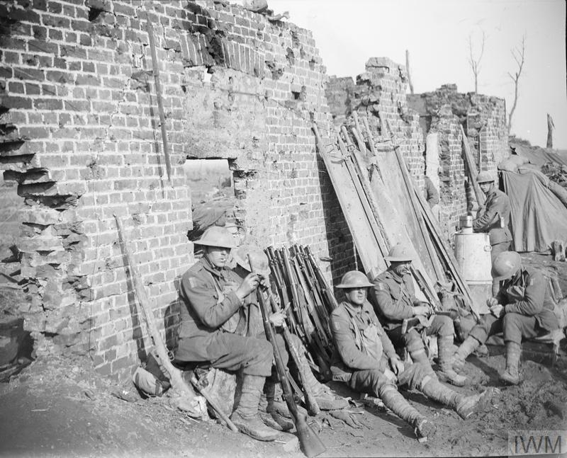 Troops of the Dorsetshire Regiment resting and cleaning rifles in the ruins of a farm near Langemarck, 17 October 1917. Troops of the Dorsetshire Regiment resting and cleaning rifles in the ruins of a farm near Langemarcke, 17 October 1917. Copyright: © IWM. Original Source: http://www.iwm.org.uk/collections/item/object/205238113