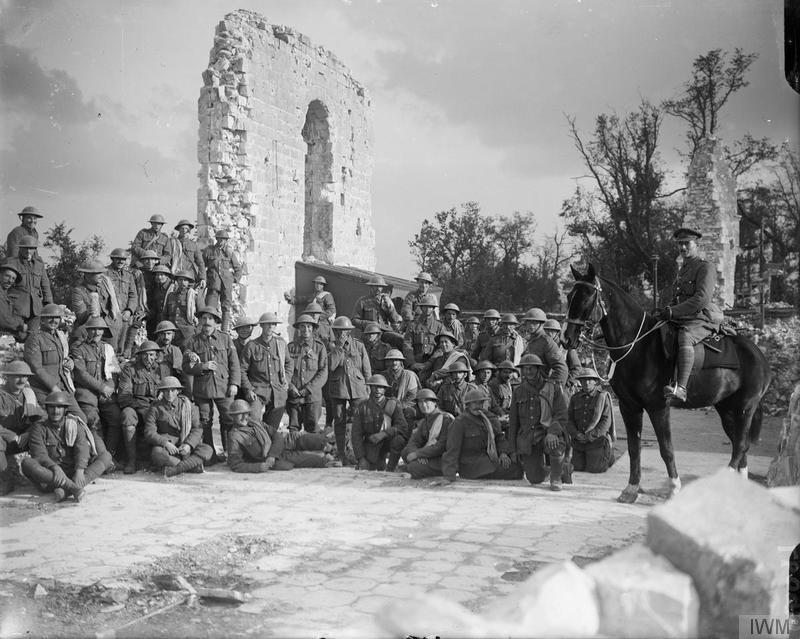 Troops of the 7th (Service) Battalion, Suffolk Regiment, in the ruins of the church in Tilloy [near Arras], 18 October 1917. Imperial War Museum image Q6097