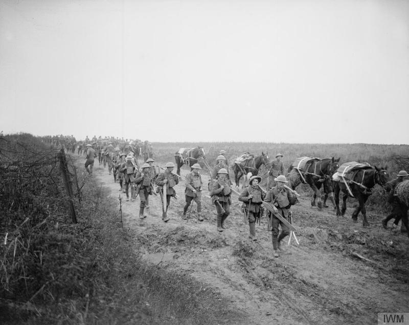 Men of the 16th (Service) Battalion, Royal Irish Rifles (Pioneers of the 36th Ulster Division) moving forward along the Ribecourt road, 20 November 1917. Battle of Cambrai. Imperial War Museum image Q6291