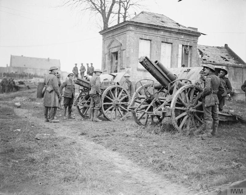 British soldiers examine two German field guns captured by the 11th (Servic) Battalion, Essex Regiment, at Ribecourt, 22 November 1917. Imperial War Museum image Q6313