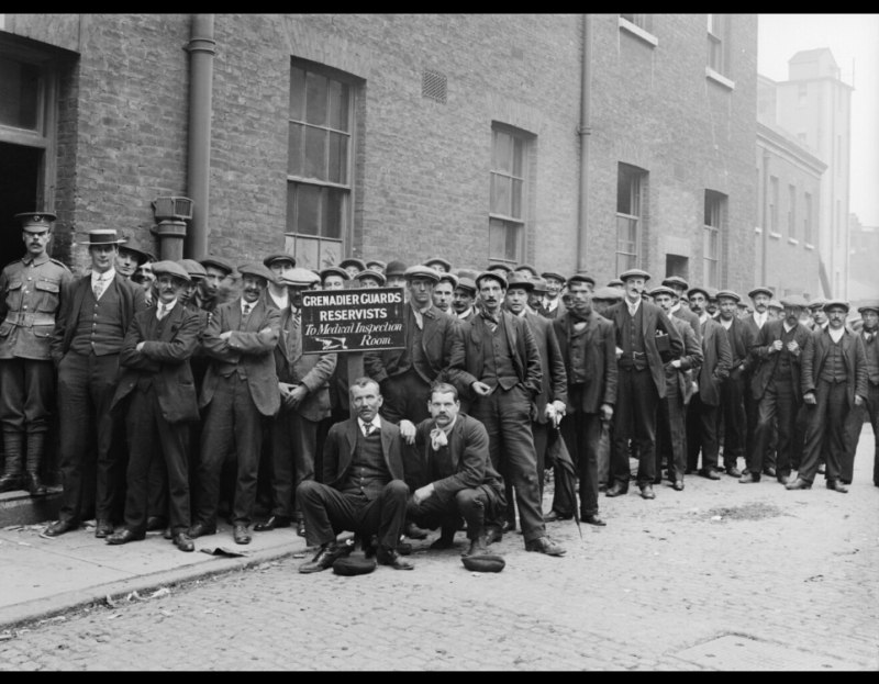Reservists of the Grenadier Guards re-enlisting on the outbreak of War, queue for a medical inspection at Wellington Barracks, Westminster, London, 5 August 1914. Imperial War Museum image Q67397. If these men were reservesist they were not, technivally, re-enlisting but reporting back for full-time duty having received a mobilisation notice.