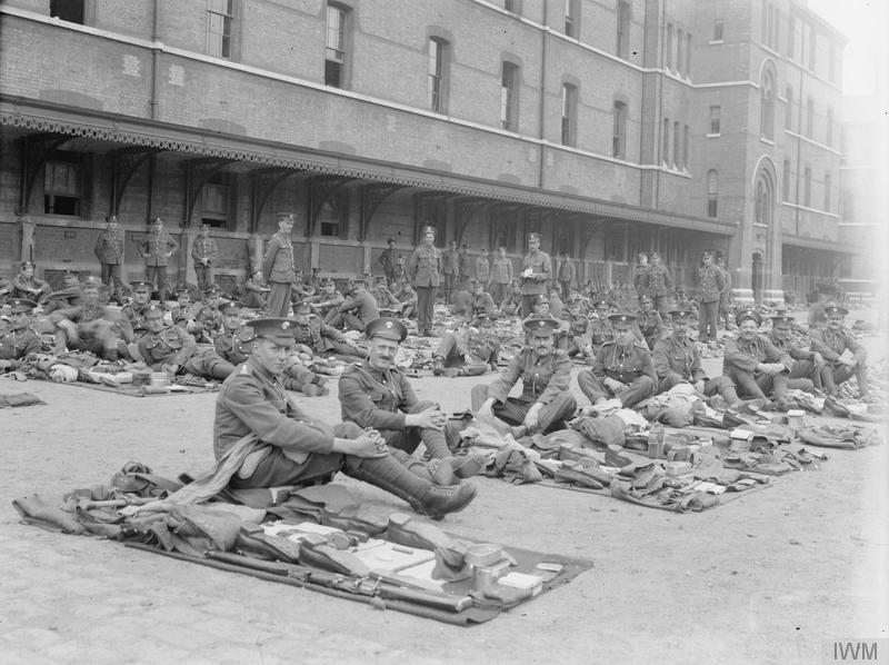 Grenadier Guards with kit laid out for inspection. 5th Battalion at Wellington Barracks. Imperial War Museum image Q67407