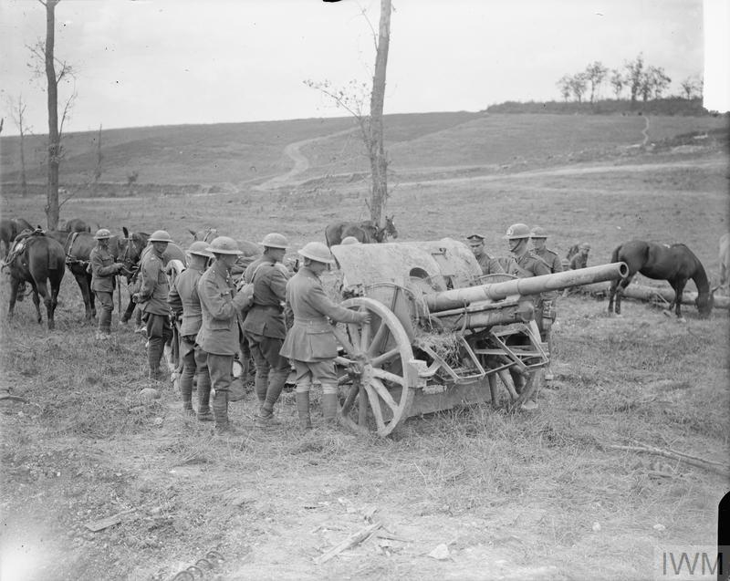 Imperial war Museum image Q 6925. Battle of Amiens. Gunners of the Royal Horse Artillery (RHA) examining a captured German 77mm field gun and Maxim machine gun. Malard Wood, 9 August 1918.
