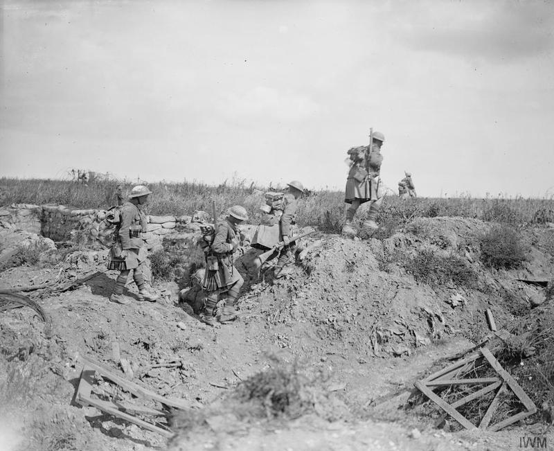 Battle of the Scarpe. Capture of the Greenland Hill by the 51st Division. Daylight patrol of the 6th Battalion, Seaforth Highlanders working forward towards Hausa and Delbar Woods. North-east of Roeux, 29 August 1918. Troops crossing an old trench in the No Man's Land. Imperial War Museum image Q7009