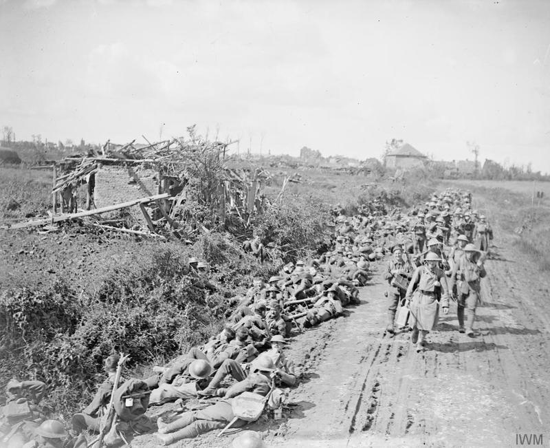 The Advance in Flanders. Troops of the Royal Inniskilling Fusiliers, 36th Division, advancing from Ravelsburg Ridge, 1 September 1918. Imperial War Museum image Q7023