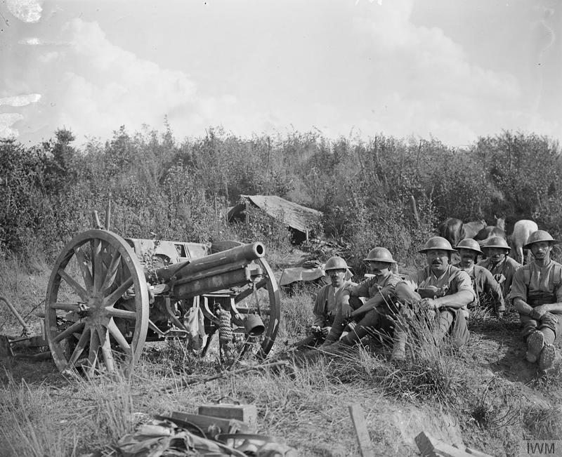 Second Battle of Bapaume. Troops of the 7th (Service) Battalion, Royal Sussex Regiment, and one of the 7.7 cm (770 mm) FK 96 n.A. guns they captured. Near Moislains, 5 September 1918. Imperial War Museum image Q7045