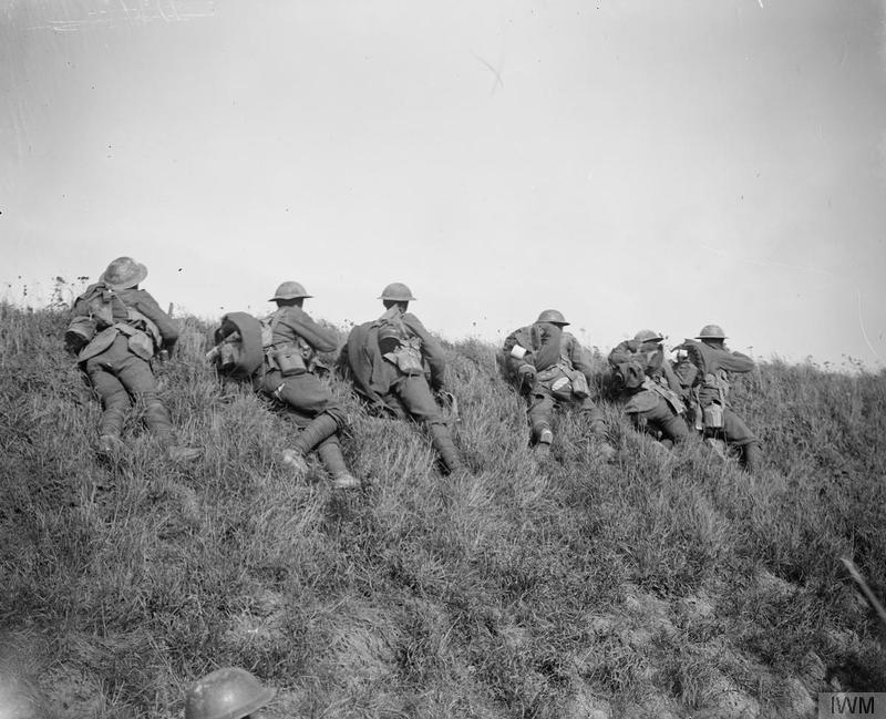 Men of the 4th Battalion, Leicestershire Regiment (46th Division) firing at German snipers and machine gunners on the edge of the Bois de Riquerval near Bohain, 10 October 1918. Imperial War Museum image Q7104