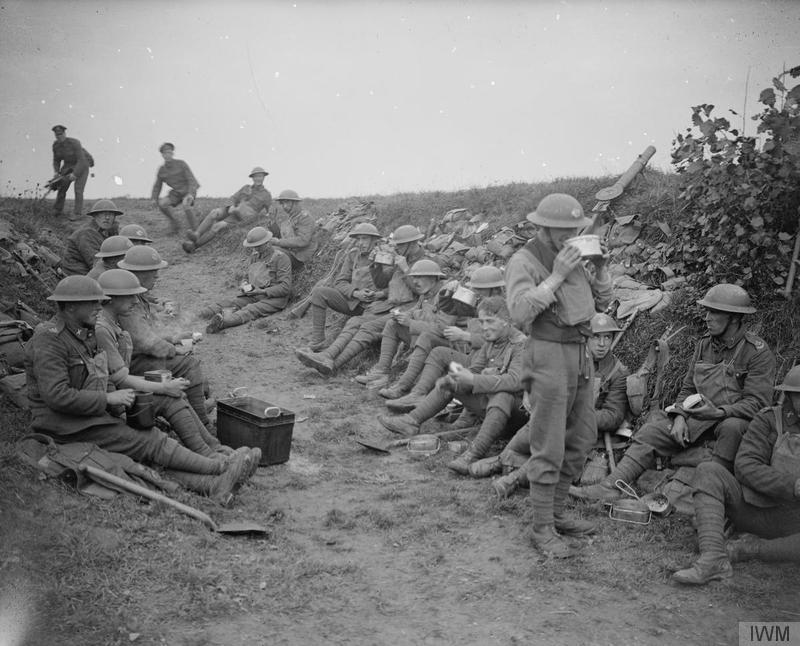 Troops of No. 1 Platoon, A Company, 10th Battalion, Duke of Cornwall's Light Infantry (DCLI) breakfasting on their way to the line. Near Le Quesnoy, 27 October 1918. Imperial War Museum image Q7154