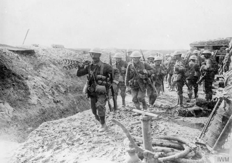 Wiring party of the 1st Battalion, Lancashire Fusiliers going up to the trenches. Beaumont Hamel, July 1916. Note a trench pump in the foreground. Imperial War Museum image Q731