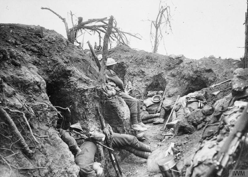 Troops of the Border Regiment resting in a front line trench in Thiepval Wood, August 1916. Imperial War Museum image Q871