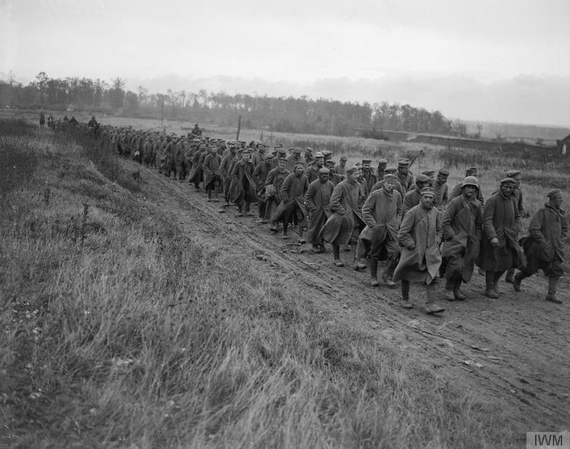 Battle of Cambrai, 1918. Prisoners taken by 63rd (Royal Naval) Division being marched in near Noyelles, 8 October 1918. Imperial War Museum image Q9513