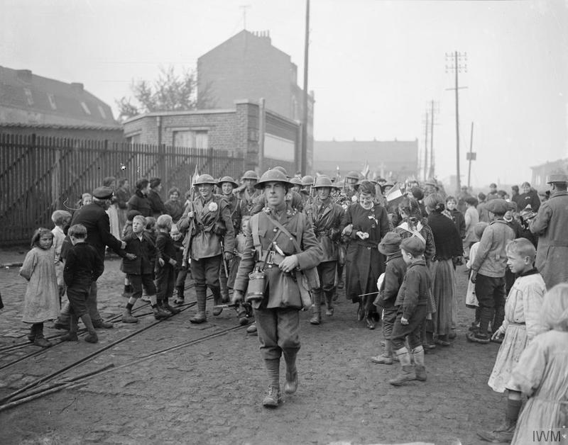 Troops of the 8th (Irish) Battalion, the King's (Liverpool Regiment)  entering Lille, 18 October 1918. Imperial War Museum image Q9572