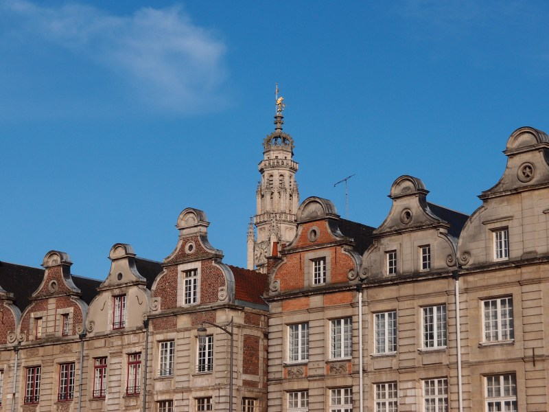 Beautiful architecture at the Grande Place in Arras, with the spire of the Town Hall behind it. Who would guess that the town was devastated in the Great War and much of what you see is rebuilt?