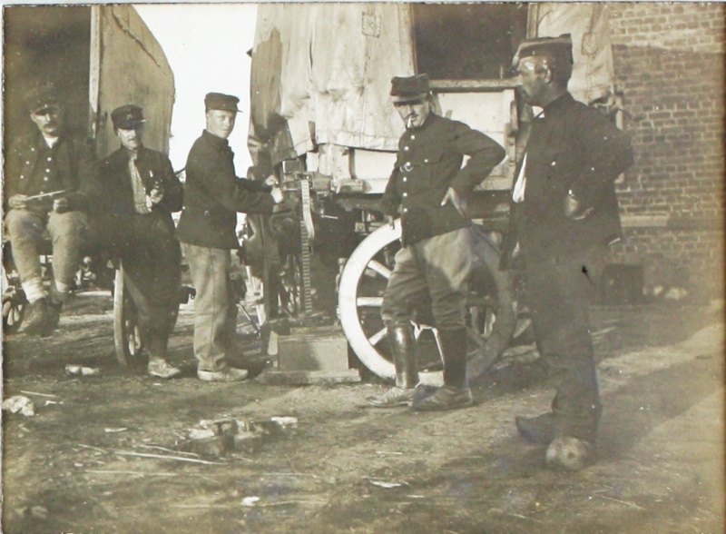 Belgian machine gunners loading a Maxim gun. From a photograph album of Kapitein Gilbert of the 17th Line Infantry. Image provided by Europeana, originally from Charlotte Saelemakers, and published under Creative Commons Licence.