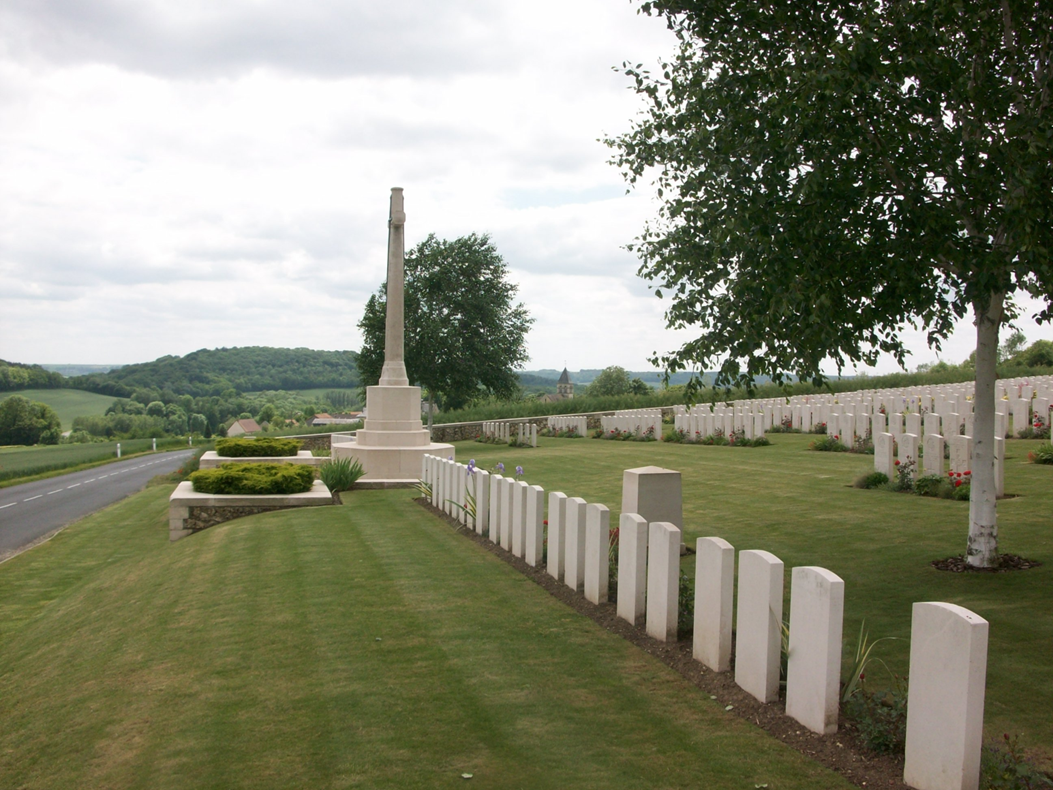 A view of Vendresse British Cemetery, looking down the slope towards the River Aisne. Vendresse church tower can be seen behind the cemetery. The wooded slopes make the Aisne today a pretty, gentle area that belies the horrors it witnesses in the Great War.