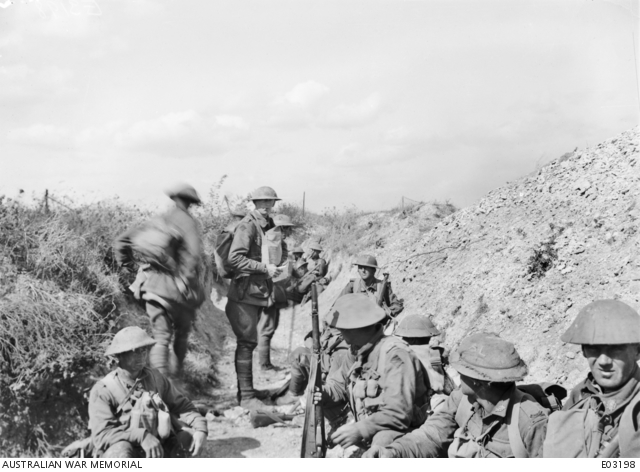 Captain Sullivan MC and Bar MM, Officer Commanding A Company, 21st Battalion, in Elsa Trench with some of his men, immediately before going out to participate in the attack on Mont St Quentin, at 1.30 pm, on 1 September 1918. It was with this renewed assault that the enemy resistance was broken and the whole position of Mont St Quentin won. Australian War Memorial image EO3198