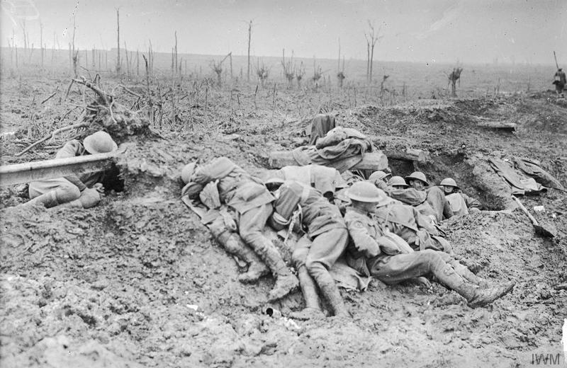 Exhausted stretcher bearers from the 3rd Australian Division rest in the mud and drizzle of Broodseinde Ridge, during the Third Battle of Ypres (Passchendaele), 11 October 1917. Imperial War Museum image E(AUS)941 from the Australian War Memorial