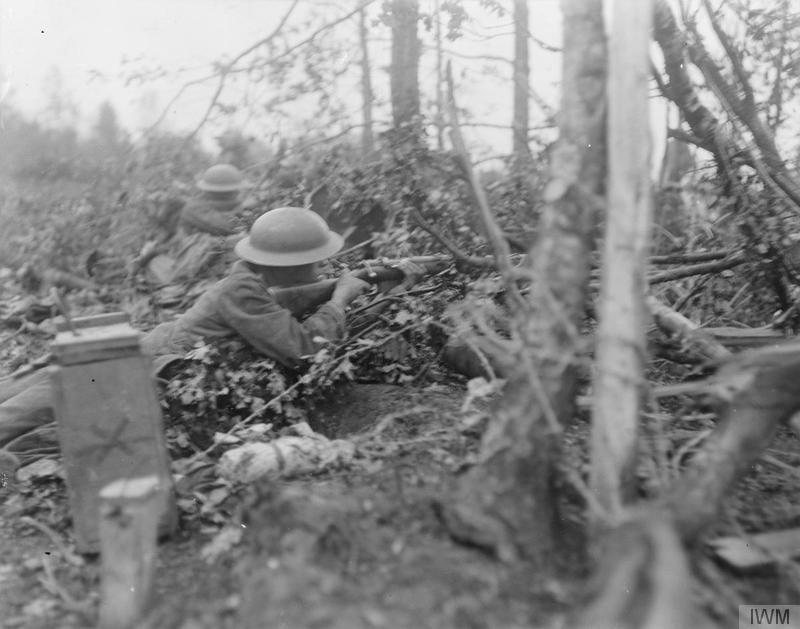 Battle of Tardenois. Infantry men of the 62nd Division looking out for the enemy in the Bois de Reims. Imperial War Museum image Q11089
