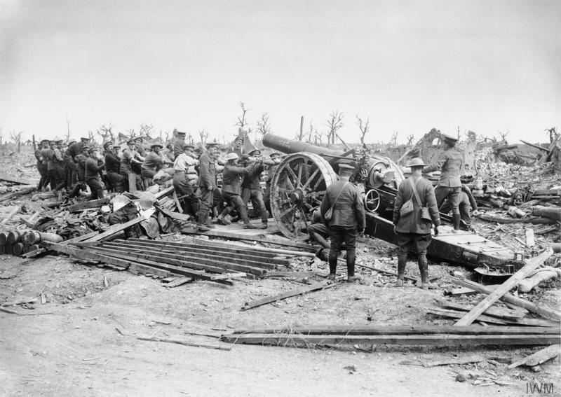 Gunners of the 156th Siege Battery, Royal Garrison Artillery hauling a 8 inch howitzer into position at Longueval, September 1916. Imperial War Museum image Q1374