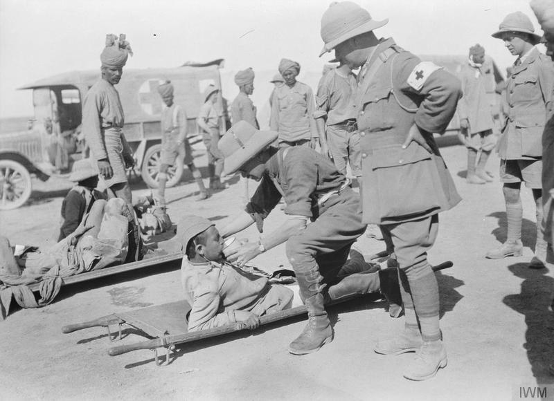 Wounded Turks being tended at an Indian advanced dressing station after the action at Tikrit on the Tigris river, Mesopotamia, November 1917. During the assault on a well dug-in enemy British, Sikh and Punjabi troops distinguished themselves. Imperial War Museum image Q24439