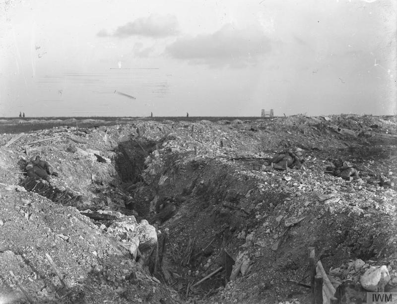 British dead in front of a captured German trench; near Loos, 30th September, 1915. The towers of Loos can be seen in the distance. Royal Engineers collection at the Imperial War Museum, image Q28980