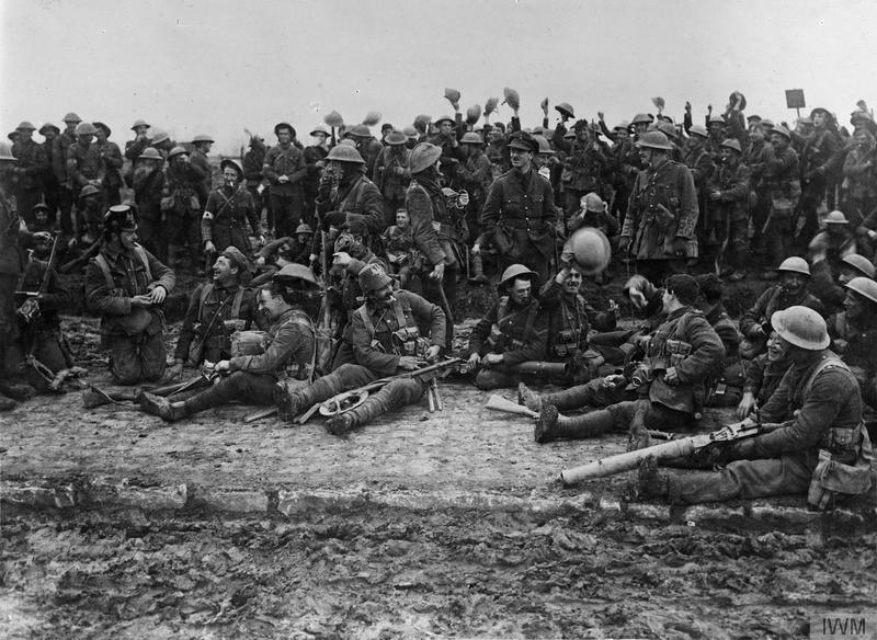 Actions of St. Eloi Craters. Troops of the Northumberland Fusiliers, 3rd Division, wearing German helmets and gas masks captured at St. Eloi, 27 March 1916 Imperial War Museum image Q495