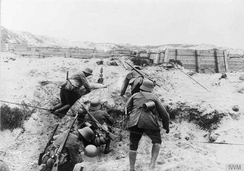 A German minenwerfer (trench mortar) section in action in the dunes on the Flanders Coast, July 1917. Imperial War Museum image Q50665