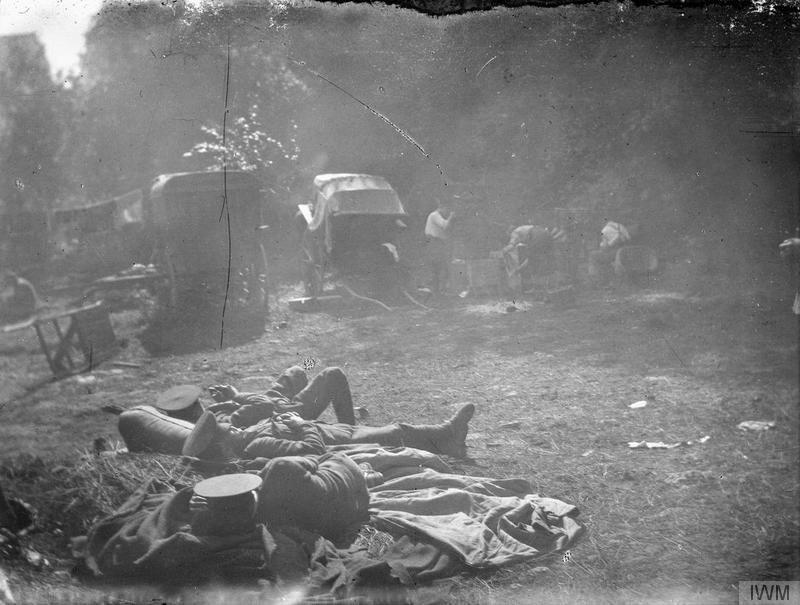 Soldiers of the 11th Regiment Hussars (Prince Albert's Own) rest at headquarters at Babonval during the Battle of the Aisne. 22nd-28th September 1914. Imperial War Museum image Q51148